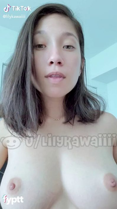 Flawless Asian girl showing nice nude TikTok boobs while doing makeup tutorial