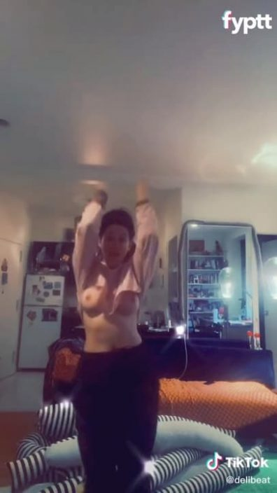 TikTok thot lift her arms all the way up and show a whole nipple slip