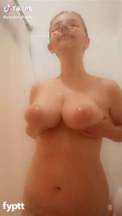 Funny girl making her big tits dance to the music in bathroom TikTok nude