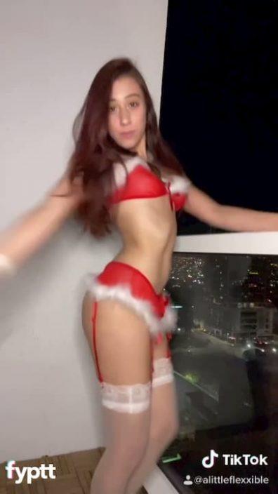 Sexy TikTok girl dancing and twerking in naughty Christmas lingerie