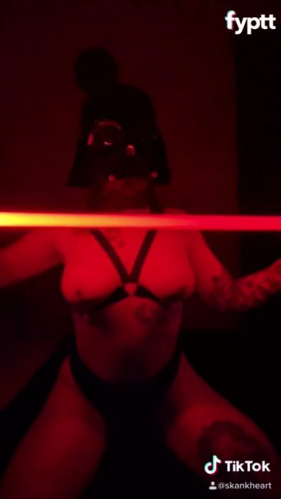 Girl with Darth Vader mask and lightsaber showing her tits on NSFW TikTok