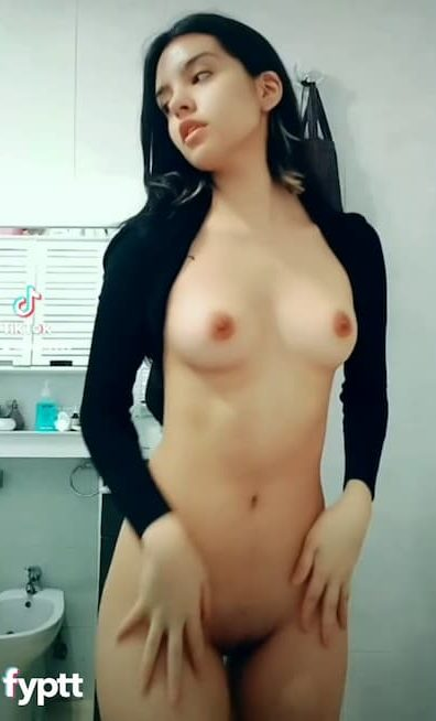 Beautiful latina dancing naked and shaking her small tits on TikTok