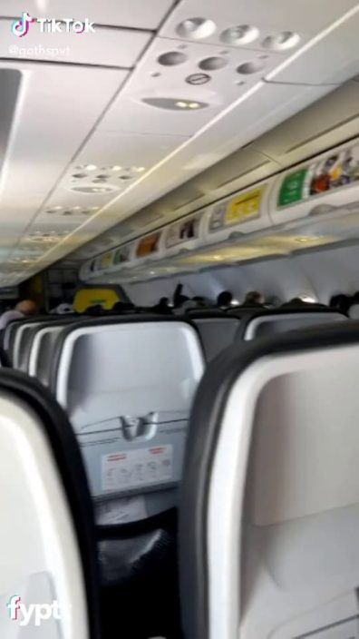 TikTok thot flashes her juicy big pierced tits in the airplane